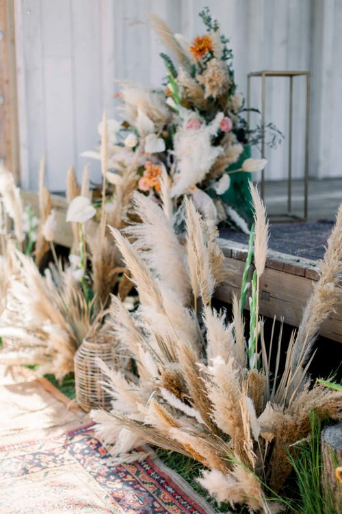 Dried Flower Stems and Grasses  in Wicker Baskets