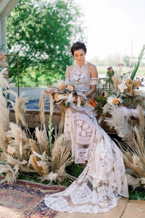 Bride in Rue de Seine Boho Wedding Dress with Halter Neck Detail and Tassel  Arm Cuffs