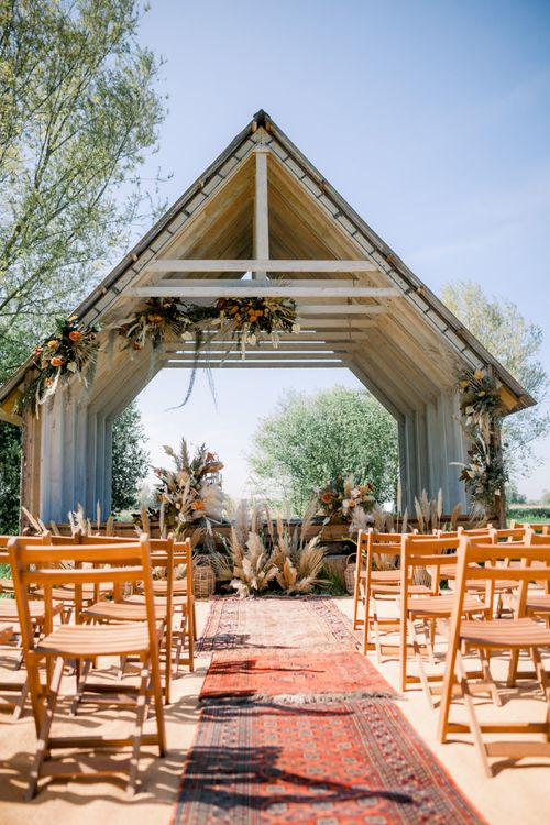 Outdoor Ceremony at a Woodman's Cabin Decorated with Dried Foliage, Flowers and Grasses including Pampas