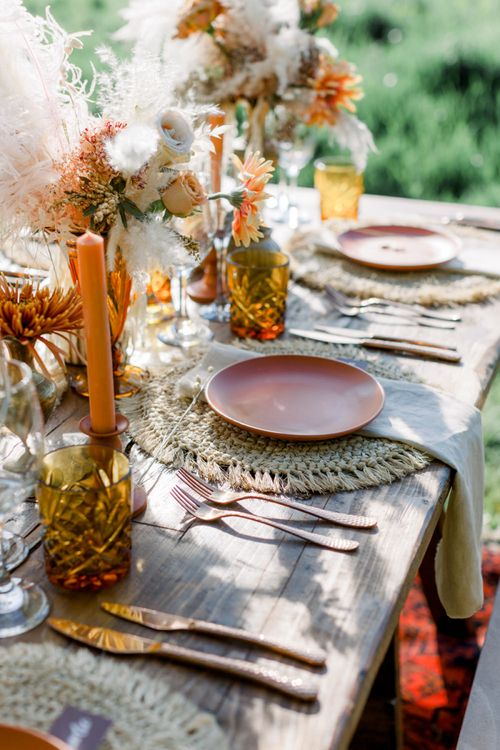 Ratan Place Setting with Gold Cutlery, Orange Candles and Dried Flowers