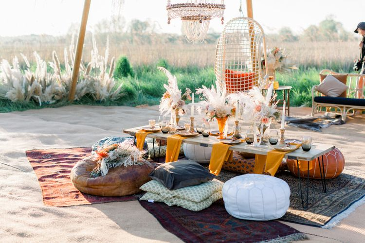 Relaxed Tablescape with Moroccan Poufs, Dried Flower Arrangements and Persian Rugs