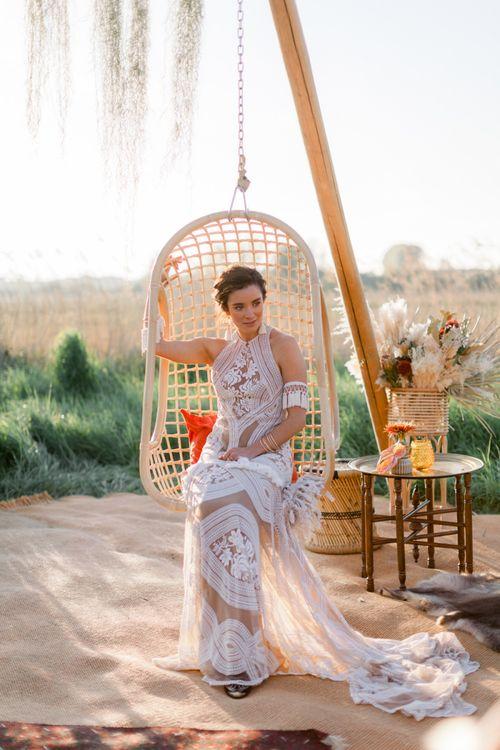 Bride in Rue De Seine Boho Wedding Dress Sitting in a Swing