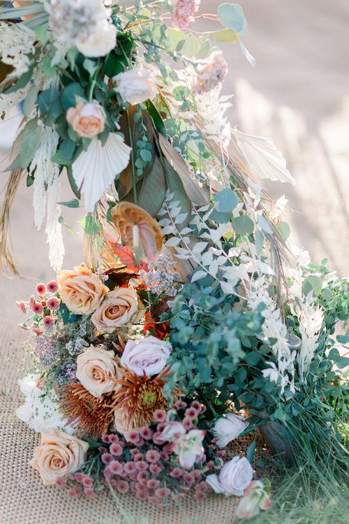 Foliage, Roses and Protea Wedding Flower Arrangement