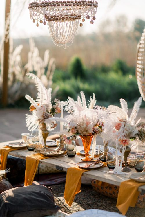 Tablescape with Orange Napkins and Vessels filled with Pampas Grass
