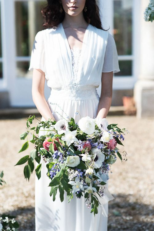 Winter Wedding Bouquet With White Anemones // Winter Wedding Inspiration At Sennowe Park Norfolk With Cornflower Blue And Gold Details With Images From Salsabil Morrison Photography