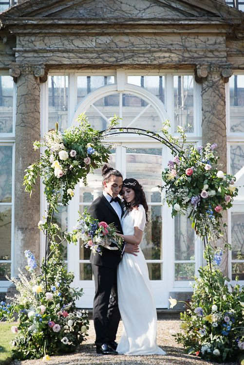 Floral Arch For Wedding Ceremony // Winter Wedding Inspiration At Sennowe Park Norfolk With Cornflower Blue And Gold Details With Images From Salsabil Morrison Photography