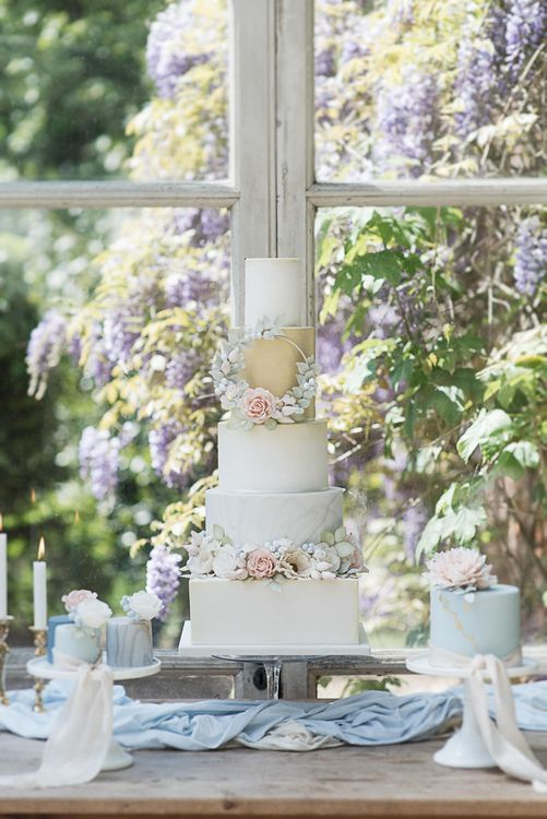 Dessert Table For Wedding With Iced Cake With Sugar Flowers // Winter Wedding Inspiration At Sennowe Park Norfolk With Cornflower Blue And Gold Details With Images From Salsabil Morrison Photography
