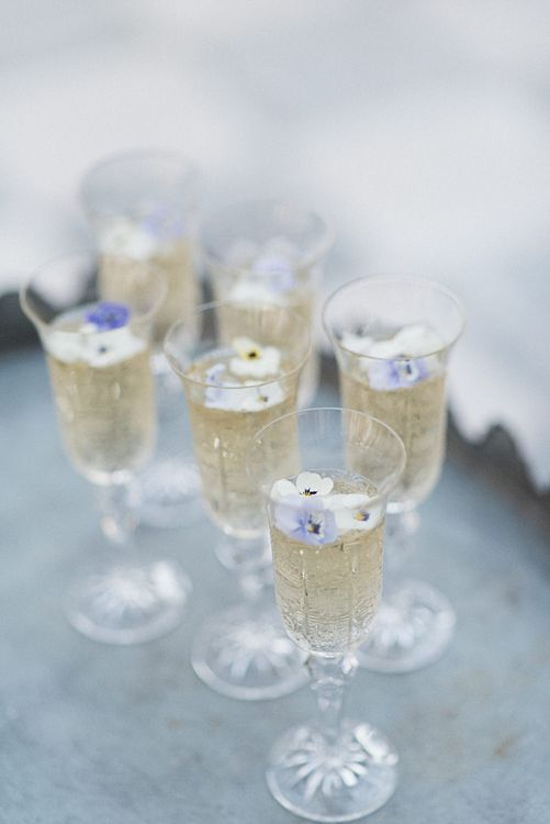 Champagne With Edible Flowers // Winter Wedding Inspiration At Sennowe Park Norfolk With Cornflower Blue And Gold Details With Images From Salsabil Morrison Photography