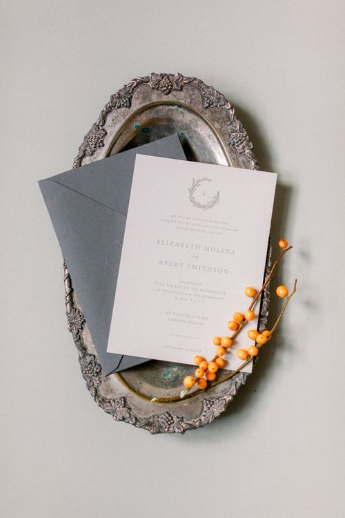 Grey and White Wedding Invitation on Silver Platter