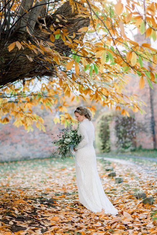 Bride in High Neck Wedding Dress Holding an Oversized Bouquet