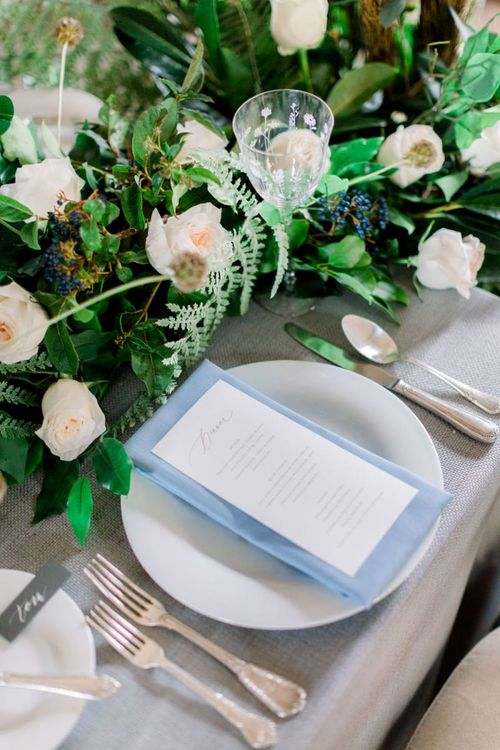 Elegant Place Setting with Blue Linen and On The Day Wedding Stationery