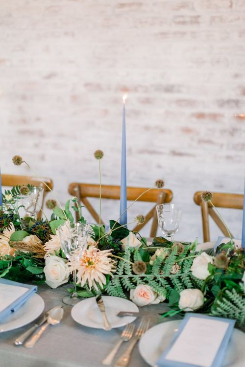 Floral Table Runner and Pale Blue Taper Candles