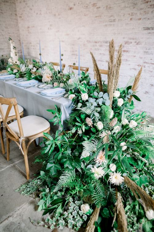 End of Table Floral Arrangement with Foliage, Dried Flowers and Roses.