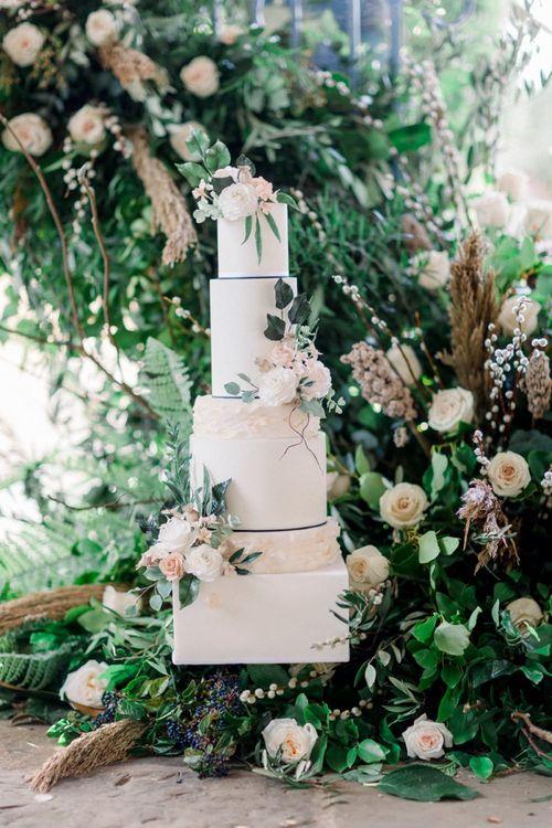 Elegant Wedding Cake Decorated with Winter Wedding Flowers