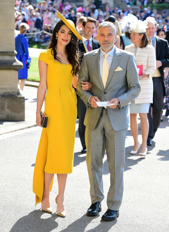 Amal Clooney In Mustard Yellow For Royal Wedding Of Prince Harry & Meghan Markle  // Image: Getty Images