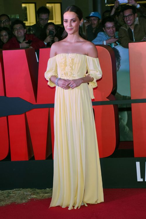 Alicia Vikander In Pale Yellow Dress // Image: Rex Images