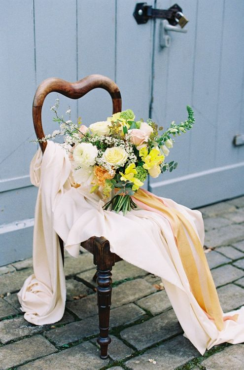 Yellow and White Wedding Bouquet Resting on a Chair