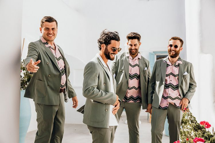 Sage green wedding suits with patterned shirts for groomsmen