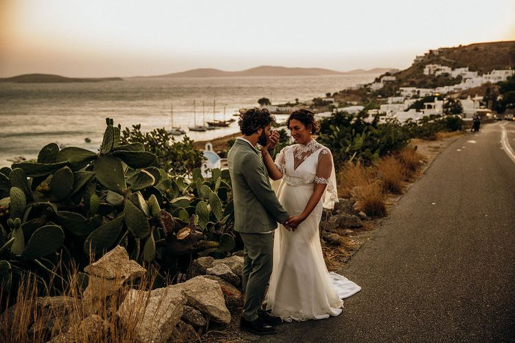 Bride and groom steal a moment together during the sunset in Mykonos