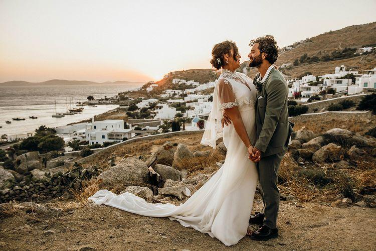 Bride in wedding capelet with groom at Mykonos wedding