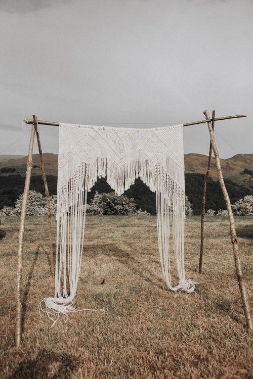 Outdoor Wedding Ceremony with Macrame Altar Backdrop