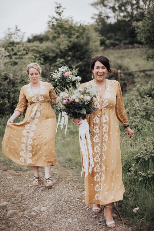 Boho Bridesmaids in Peach Dresses with White Embroidery Detail