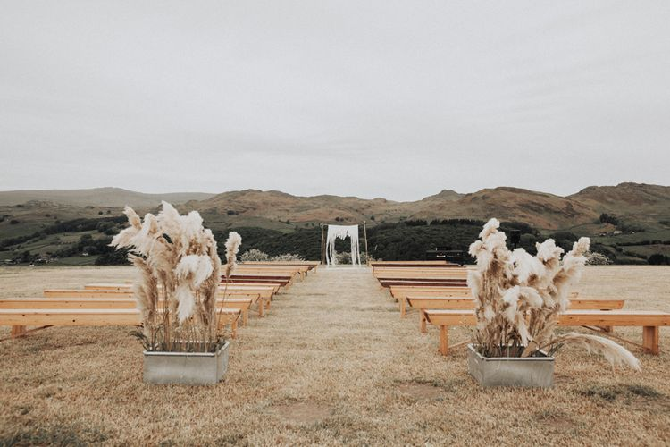 Outdoor Wedding Ceremony with Pampas Grass Floral Arrangements