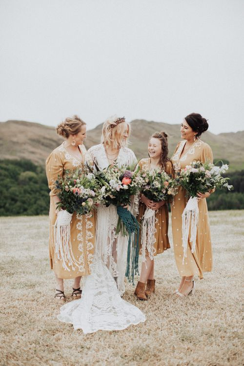 Boho Bridal Party with Bride in Rue de Seine Wedding Dress and Bridesmaids in Peach Dresses with Embroidery