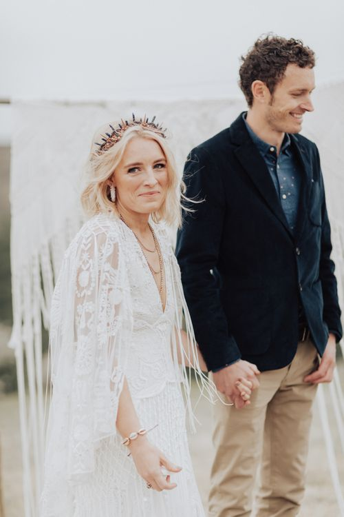 Boho Bride in Lace Rue de Seine Wedding Dress and Crown and Groom in Blazer and Chinos