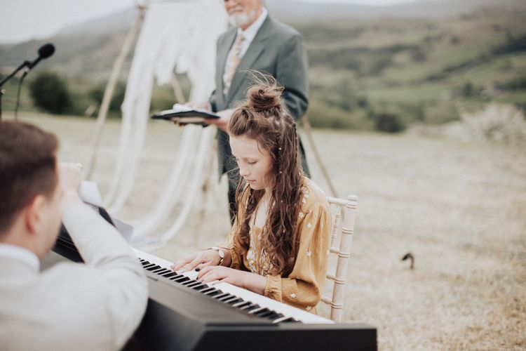 Young Bridesmaid Playing the Keyboard During the Wedding Ceremony