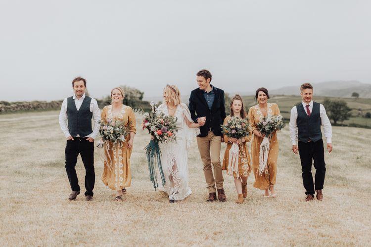 Boho Wedding Party  Walking Through the Field