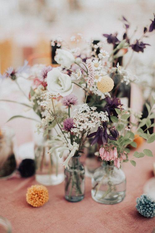 Wildflower Stems in Bottles as Wedding Decor