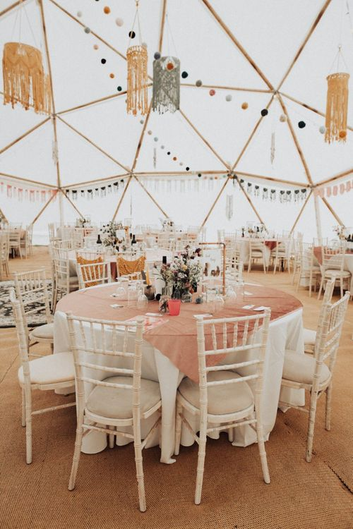 Bamboo Geodome Wedding Venue Decorated with Pom poms, Macrame Bunting and Chandeliers