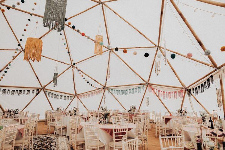 Pom poms, Macrame Bunting and Chandelier Wedding Reception Decor