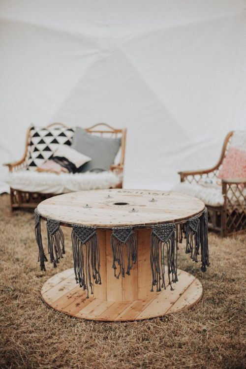 Large Cotton Reel as Table Decorated with Macrame Bunting
