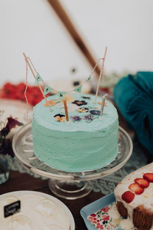 Single Tier Blue Buttercream Cake with Mini Bunting Decor
