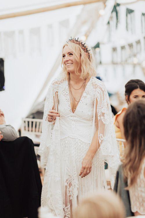 Boho Bride in Rue de Seine Wedding Dress with Tassels and Crown Headdress
