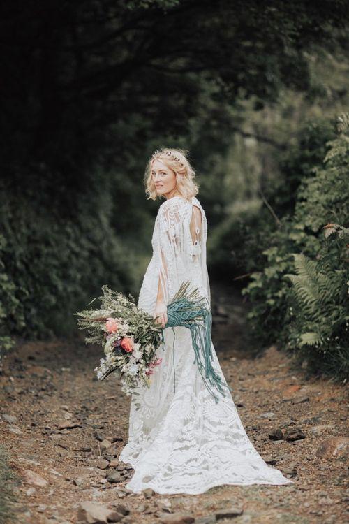 Boho Bride in Rue de Seine Wedding Dress Holding a Spring Wedding Bouquet  Tied with Macrame