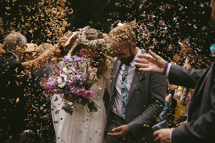 Confetti Moment   Boho Bride in Spell and The Gypsy Bridal Gown  & Flower Crown   Groom in Grey Suit   Outdoor Ceremony & DIY Rustic Barn Wedding At The Brides Parents Home   Nigel John Photography