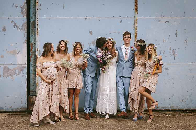 Auguste Floral Bridesmaid Dresses   Bridemates in Blue ASOS Suits   Boho Bride in Spell and The Gypsy Bridal Gown & Flower Crown   Outdoor Ceremony & DIY Rustic Barn Wedding At The Brides Parents Home   Nigel John Photography