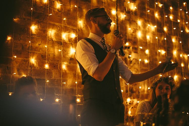 Fairy Light Backdrop   Groom in Grey Suit   Outdoor Ceremony & DIY Rustic Barn Wedding At The Brides Parents Home   Nigel John Photography