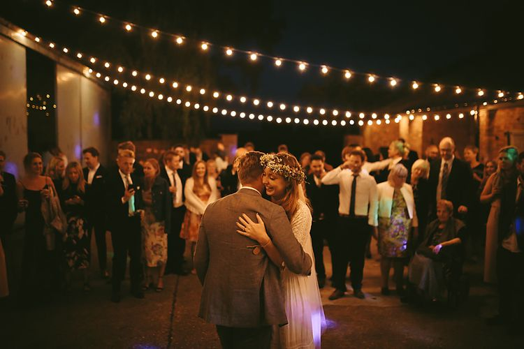 Festoon Lights   First Dance   Boho Bride in Spell and The Gypsy Bridal Gown  & Flower Crown   Groom in Grey Suit   Outdoor Ceremony & DIY Rustic Barn Wedding At The Brides Parents Home   Nigel John Photography