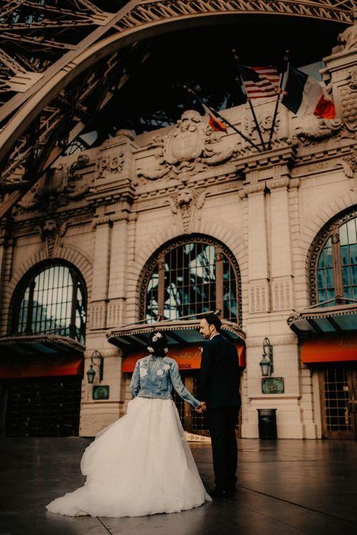 Bride wearing a personalised denim jacket walking around Las Vegas with her groom