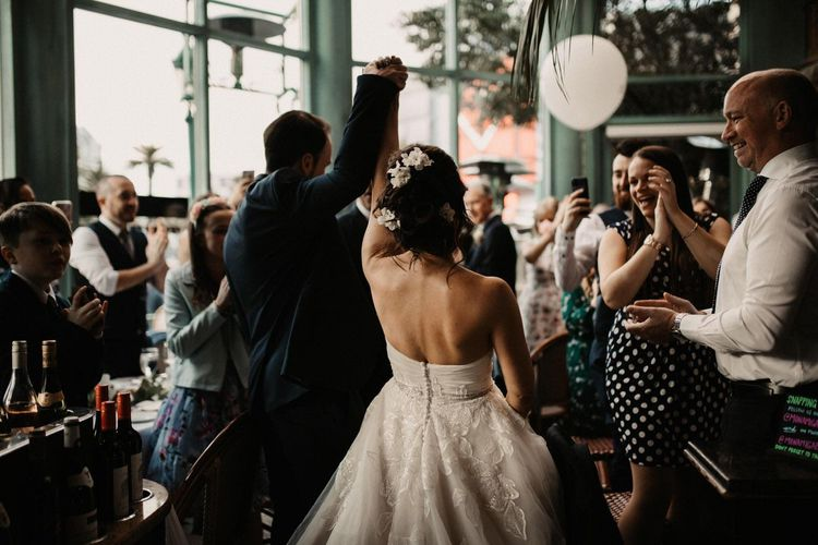 Back of brides dress as she arrives at their dinner for a Las Vegas wedding