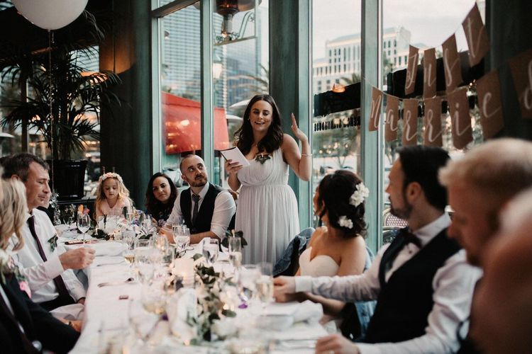Bridesmaid speeches with 'Just Married' sign and balloons