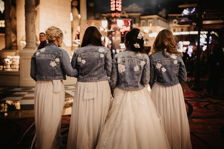 Bride and her bridal party wearing personalised denim jackets