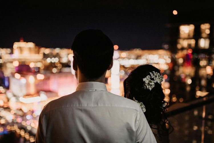 Bride and groom enjoying the view of the strip at their Las Vegas wedding