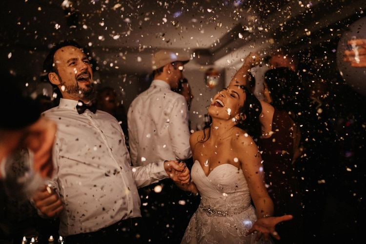 Bride and grooms first dance with gold glitter confetti