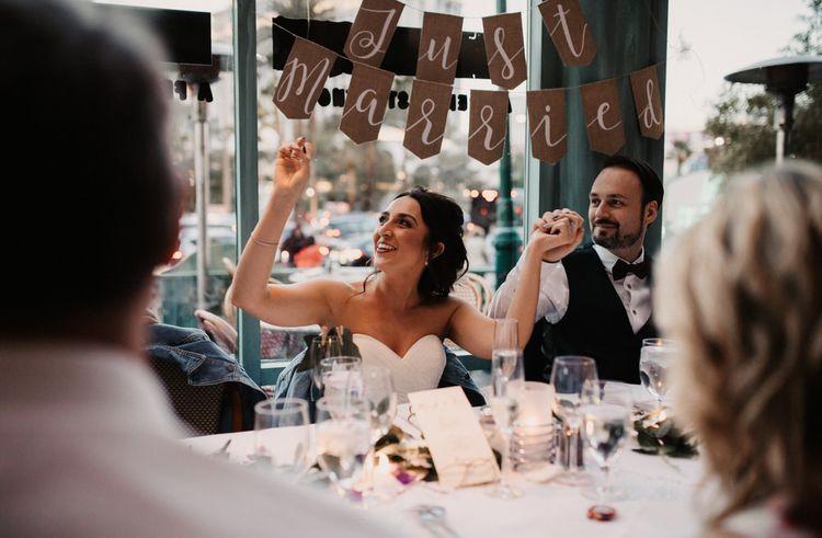 Bride and groom enjoying a sing-along at Las Vegas wedding dinner