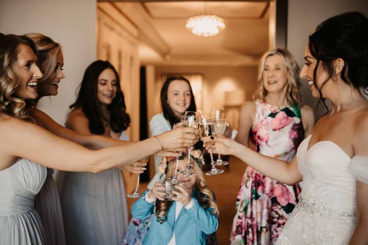 Bride and her bridal party cheers to the big day